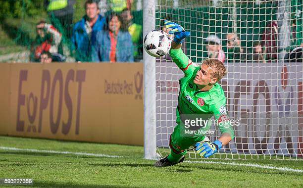 Goalkeeper Jonas Loessl of Mainz 05 makes a save during the penalty shoot out during the DFB Cup match between SpVgg Unterhaching and 1 FSV Mainz 05...