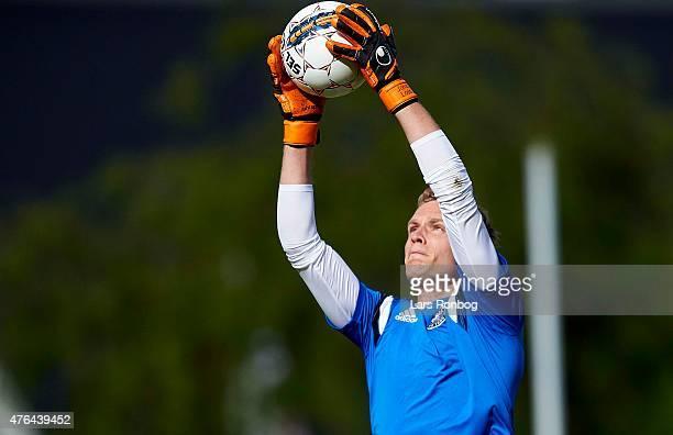 Goalkeeper Jonas Lossl of Denmark in action during the Denmark training session at Helsingor Stadion on June 9 2015 in Helsingor Denmark
