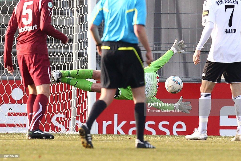 Goalkeeper Jonas Wieszt of Stuttgart fails to save the ball during the Third League match between VfR Aalen and VfB Stuttgart II at ScholzArena on...