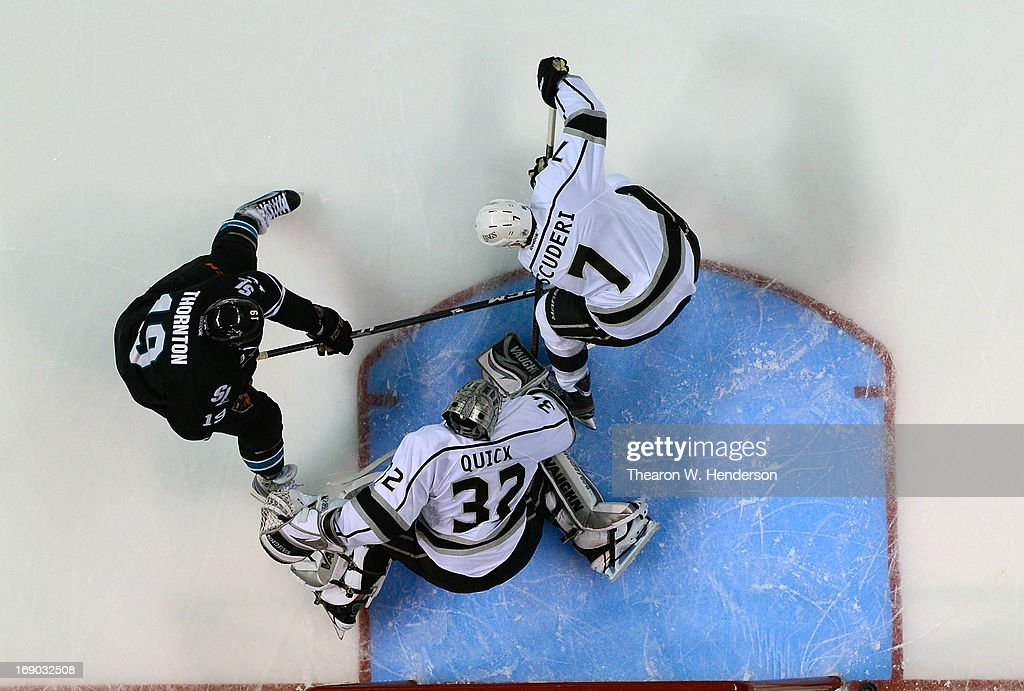 Goalkeeper <a gi-track='captionPersonalityLinkClicked' href=/galleries/search?phrase=Jonathan+Quick&family=editorial&specificpeople=2271852 ng-click='$event.stopPropagation()'>Jonathan Quick</a> #32 and <a gi-track='captionPersonalityLinkClicked' href=/galleries/search?phrase=Rob+Scuderi&family=editorial&specificpeople=228124 ng-click='$event.stopPropagation()'>Rob Scuderi</a> #7 of the Los Angeles Kings defends the net against <a gi-track='captionPersonalityLinkClicked' href=/galleries/search?phrase=Joe+Thornton&family=editorial&specificpeople=201829 ng-click='$event.stopPropagation()'>Joe Thornton</a> #19 of the San Jose Sharks in the first period in Game Three of the Western Conference Semifinals during the 2013 NHL Stanley Cup Playoffs at HP Pavilion on May 18, 2013 in San Jose, California. The Sharks defeated the Kings in overtime 2-1.