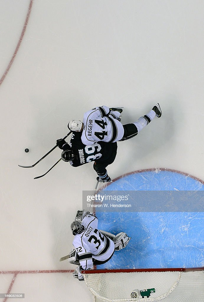 Goalkeeper <a gi-track='captionPersonalityLinkClicked' href=/galleries/search?phrase=Jonathan+Quick&family=editorial&specificpeople=2271852 ng-click='$event.stopPropagation()'>Jonathan Quick</a> #32 and <a gi-track='captionPersonalityLinkClicked' href=/galleries/search?phrase=Robyn+Regehr&family=editorial&specificpeople=171828 ng-click='$event.stopPropagation()'>Robyn Regehr</a> #44 of the Los Angeles Kings defends the net against <a gi-track='captionPersonalityLinkClicked' href=/galleries/search?phrase=Logan+Couture&family=editorial&specificpeople=809700 ng-click='$event.stopPropagation()'>Logan Couture</a> #39 of the San Jose Sharks in the third period in Game Three of the Western Conference Semifinals during the 2013 NHL Stanley Cup Playoffs at HP Pavilion on May 18, 2013 in San Jose, California. The Sharks defeated the Kings in overtime 2-1.
