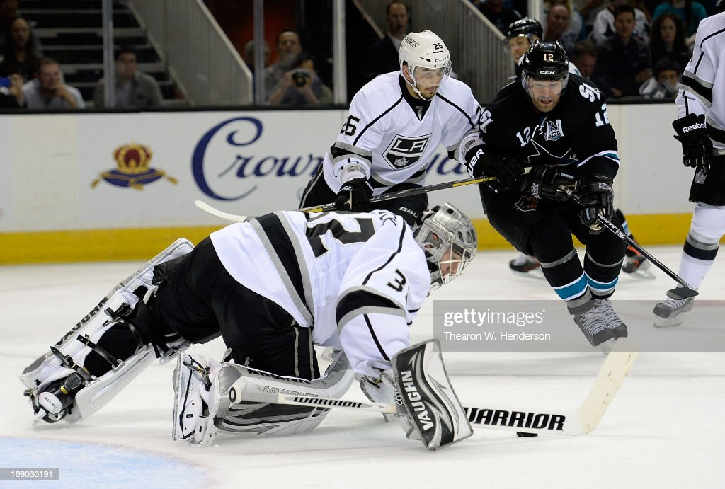 Goalkeeper <a gi-track='captionPersonalityLinkClicked' href=/galleries/search?phrase=Jonathan+Quick&family=editorial&specificpeople=2271852 ng-click='$event.stopPropagation()'>Jonathan Quick</a> #32 and <a gi-track='captionPersonalityLinkClicked' href=/galleries/search?phrase=Slava+Voynov&family=editorial&specificpeople=8315719 ng-click='$event.stopPropagation()'>Slava Voynov</a> #26 of the Los Angeles Kings defends the net against <a gi-track='captionPersonalityLinkClicked' href=/galleries/search?phrase=Patrick+Marleau&family=editorial&specificpeople=203165 ng-click='$event.stopPropagation()'>Patrick Marleau</a> #12 of the San Jose Sharks in the second period in Game Three of the Western Conference Semifinals during the 2013 NHL Stanley Cup Playoffs at HP Pavilion on May 18, 2013 in San Jose, California. The Sharks defeated the Kings in overtime 2-1.
