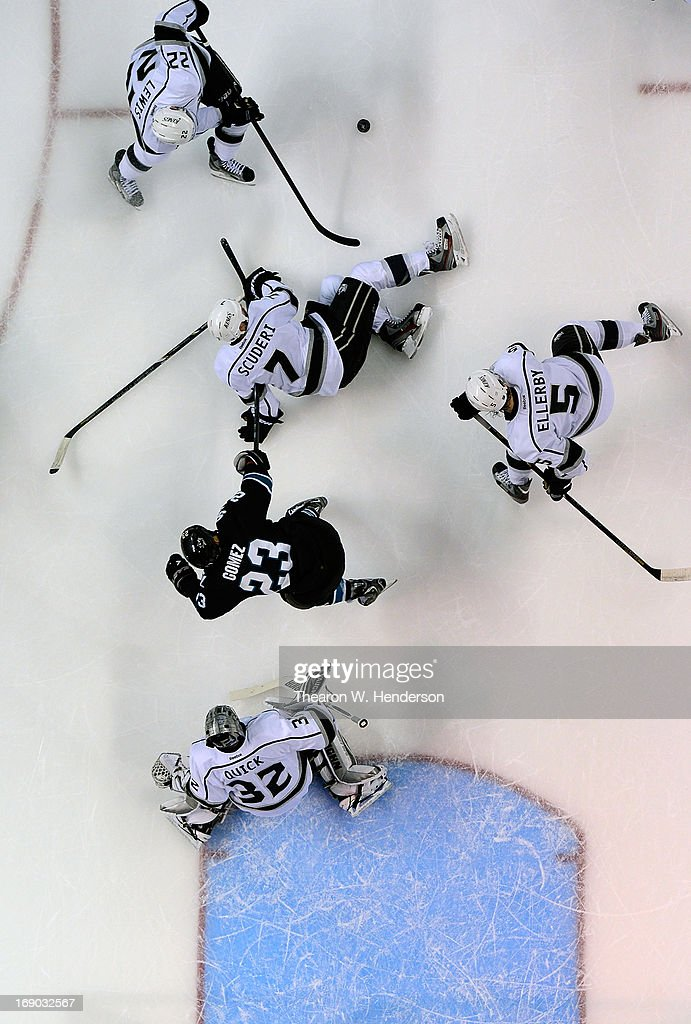 Goalkeeper <a gi-track='captionPersonalityLinkClicked' href=/galleries/search?phrase=Jonathan+Quick&family=editorial&specificpeople=2271852 ng-click='$event.stopPropagation()'>Jonathan Quick</a> #32, <a gi-track='captionPersonalityLinkClicked' href=/galleries/search?phrase=Keaton+Ellerby&family=editorial&specificpeople=4111546 ng-click='$event.stopPropagation()'>Keaton Ellerby</a> #5, <a gi-track='captionPersonalityLinkClicked' href=/galleries/search?phrase=Trevor+Lewis&family=editorial&specificpeople=543187 ng-click='$event.stopPropagation()'>Trevor Lewis</a> #22 and <a gi-track='captionPersonalityLinkClicked' href=/galleries/search?phrase=Rob+Scuderi&family=editorial&specificpeople=228124 ng-click='$event.stopPropagation()'>Rob Scuderi</a> #7 of the Los Angeles Kings defends the net against <a gi-track='captionPersonalityLinkClicked' href=/galleries/search?phrase=Scott+Gomez&family=editorial&specificpeople=201782 ng-click='$event.stopPropagation()'>Scott Gomez</a> #23 of the San Jose Sharks in the first period in Game Three of the Western Conference Semifinals during the 2013 NHL Stanley Cup Playoffs at HP Pavilion on May 18, 2013 in San Jose, California. The Sharks defeated the Kings in overtime 2-1.