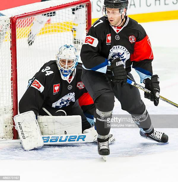 Goalkeeper Joni Myllykoski and Tyler Gotto of Vojens look on during the Champions Hockey League group stage game between SonderjyskE Vojens and HV71...