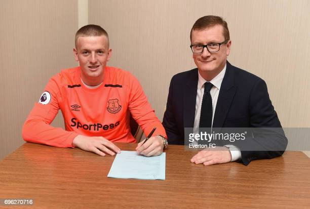 Goalkeeper Jordan Pickford looks on as he signs for Everton alongside club secretary David Harrison at the Binkowski Hotel on June 14 2017 in Kielce...