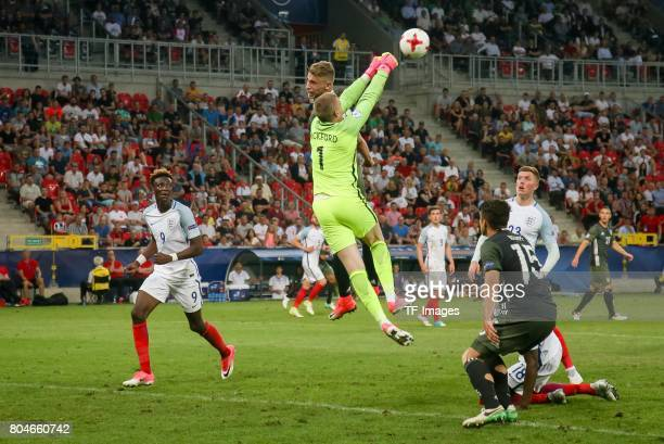 Goalkeeper Jordan Pickford of England and Felix Platte of Germany battle for the ball during the UEFA European Under21 Championship Semi Final match...