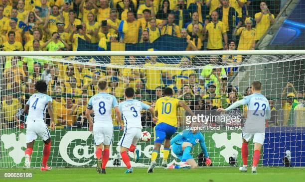 Goalkeeper Jordan Pickford of England saves a penalty from Linus Wahlqvist of Sweden during the UEFA European Under21 Championship match between...