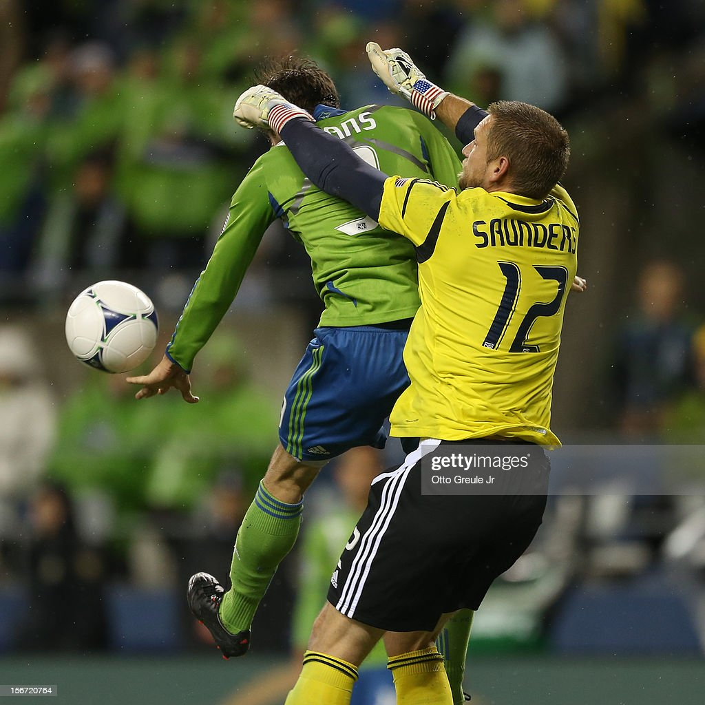 Goalkeeper Josh Saunders #12 of the Los Angeles Galaxy battles Brad Evans #3 of the Seattle Sounders FC during Leg 2 of the Western Conference Championship at CenturyLink Field on November 18, 2012 in Seattle, Washington.