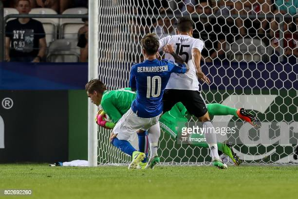 Goalkeeper Julian Pollersbeck of Germany MarcOliver Kempf of Germany and Federico Bernardeschi of Italy battle for the ball during the UEFA U21...