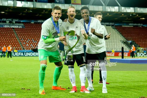 Goalkeeper Julian Pollersbeck of Germany Maximilian Arnold of Germany Gideon Jung of Germany celebrates with the trophy after the UEFA U21 Final...