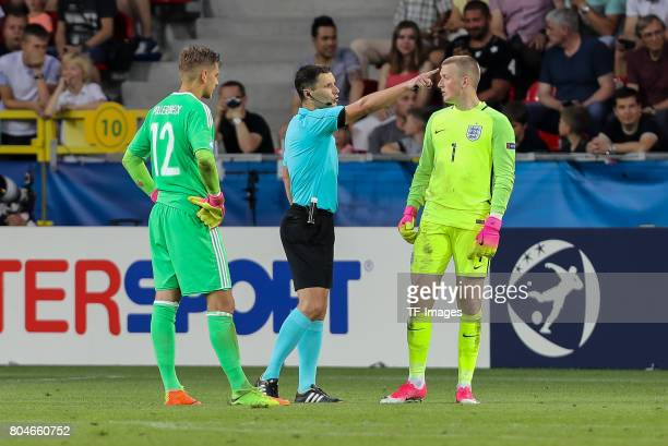 Goalkeeper Julian Pollersbeck of Germany referee Gediminas Mazeika of Lithuania Goalkeeper Jordan Pickford of England during the UEFA European...