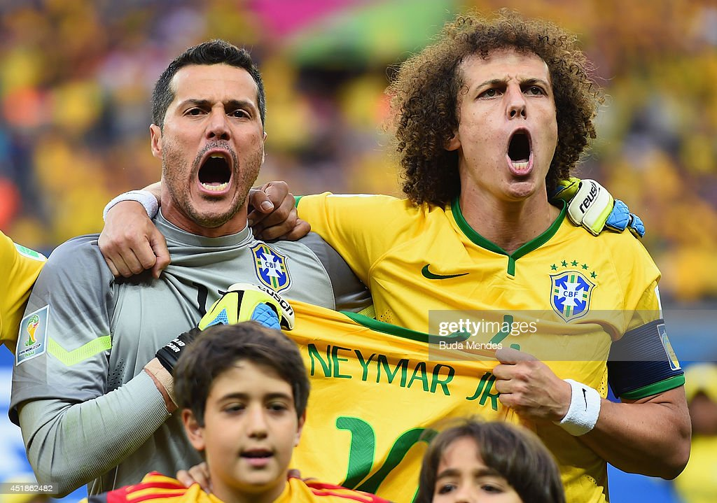 Goalkeeper Julio Cesar (L) and <a gi-track='captionPersonalityLinkClicked' href=/galleries/search?phrase=David+Luiz&family=editorial&specificpeople=4133397 ng-click='$event.stopPropagation()'>David Luiz</a> of Brazil hold a Neymar jersey as they sing the National Anthem prior to the 2014 FIFA World Cup Brazil Semi Final match between Brazil and Germany at Estadio Mineirao on July 8, 2014 in Belo Horizonte, Brazil.