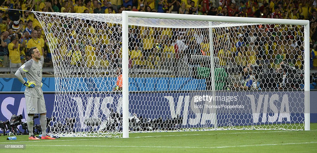 Goalkeeper Julio Cesar of Brazil after conceding his 7th goal of the match during the 2014 FIFA World Cup Brazil Semi Final match between Brazil and Germany at Estadio Mineirao on July 8, 2014 in Belo Horizonte, Brazil. Germany won the match 7-1.