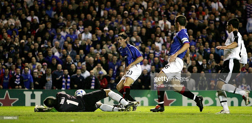 Goalkeeper Juraj Cobej of Artmedia Bratislava dives to save a shot by Federico Nieto of the Glasgow Rangers during their UEFA Champions League group H match held at Ibrox October 19, 2005 in Glasgow, Scotland.