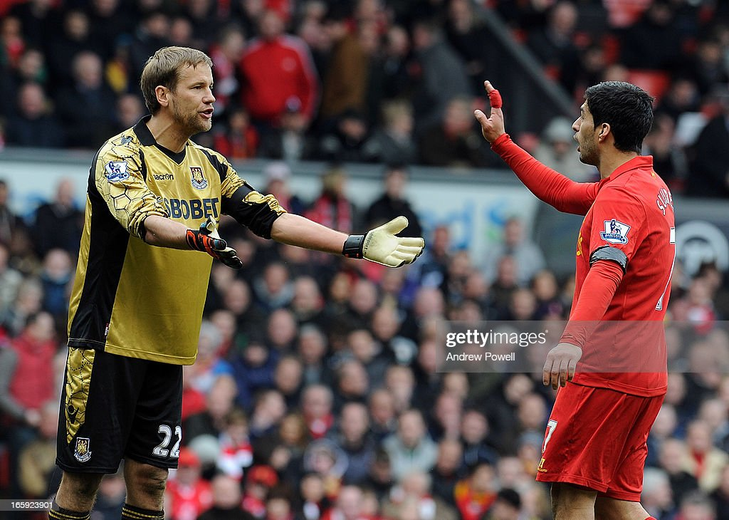Goalkeeper Jussi Jaaskelainen of West Ham United and Luis Suarez of Liverpool have words during the Barclays Premier League match between Liverpool and West Ham United at Anfield on April 7, 2013 in Liverpool, England.