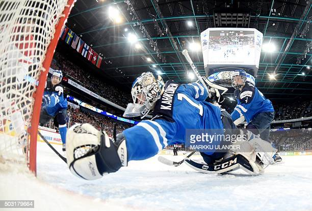 Goalkeeper Kaapo Kahkonen of Finland makes a save during the 2016 IIHF World Junior Ice Hockey Championship quarterfinal match between Finland and...