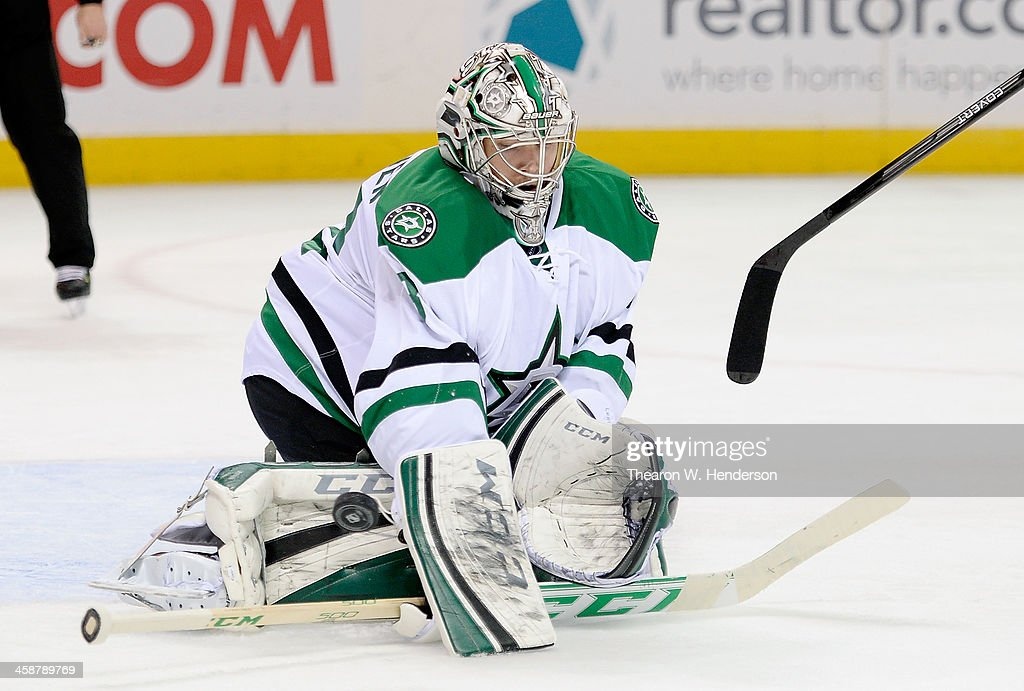Goalkeeper <a gi-track='captionPersonalityLinkClicked' href=/galleries/search?phrase=Kari+Lehtonen&family=editorial&specificpeople=211612 ng-click='$event.stopPropagation()'>Kari Lehtonen</a> #32 of the Dallas Stars makes a stick hand save against the San Jose Sharks during the second period at SAP Center on December 21, 2013 in San Jose, California.