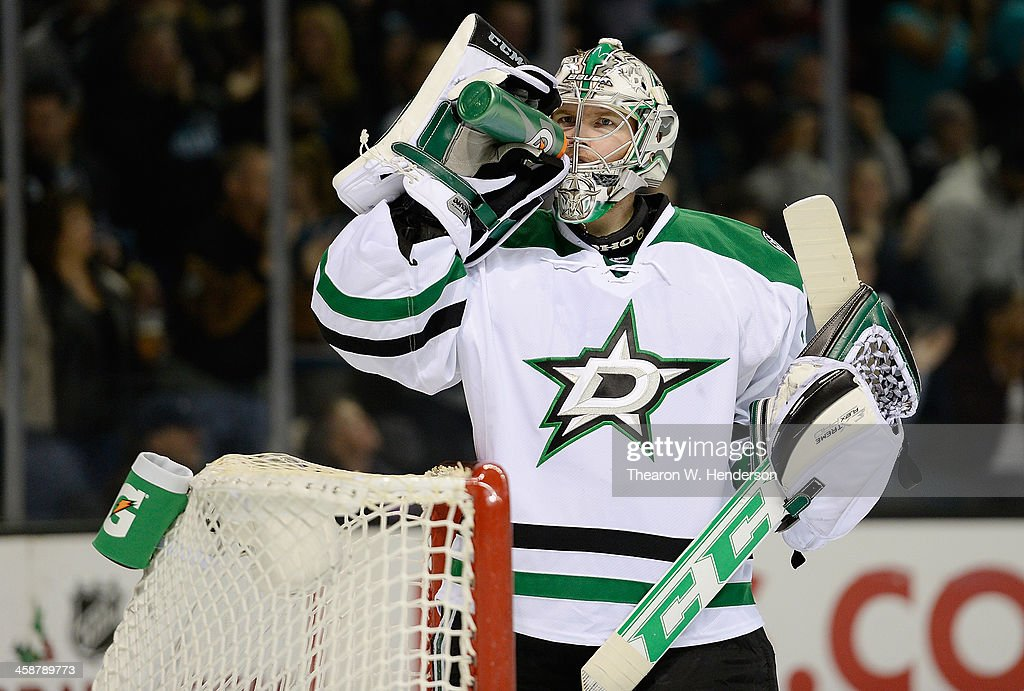 Goalkeeper <a gi-track='captionPersonalityLinkClicked' href=/galleries/search?phrase=Kari+Lehtonen&family=editorial&specificpeople=211612 ng-click='$event.stopPropagation()'>Kari Lehtonen</a> #32 of the Dallas Stars takes a drink of water after giving up a goal to Jason Demers #5 of the San Jose Sharks (not pictured) during the second period at SAP Center on December 21, 2013 in San Jose, California.