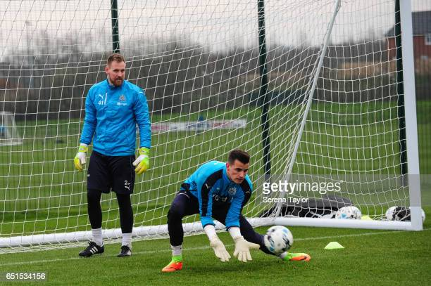 Goalkeeper Karl Darlow dives for the ball during the Newcastle United Training Session at The Newcastle United Training Centre on March 10 2017 in...