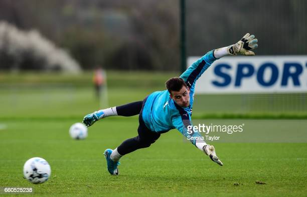 Goalkeeper Karl Darlow dives in attempt to save the ball during the Newcastle United Training Session at The Newcastle United Training Centre on...