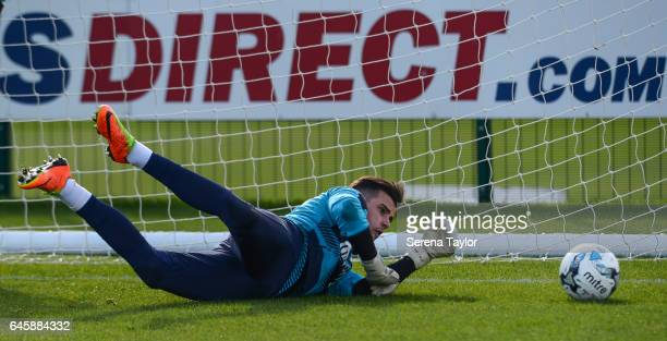 Goalkeeper Karl Darlow dives to make a save during the Newcastle United Training Session at The Newcastle United Training Centre on February 27 2017...
