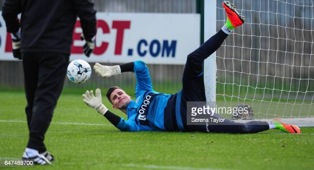 Goalkeeper Karl Darlow dives to save the ball during the Newcastle United Training Session at The Newcastle United Training Centre on March 3 2017 in...