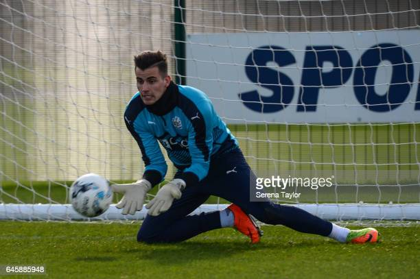 Goalkeeper Karl Darlow dives to the ground to save the ball during the Newcastle United Training Session at The Newcastle United Training Centre on...