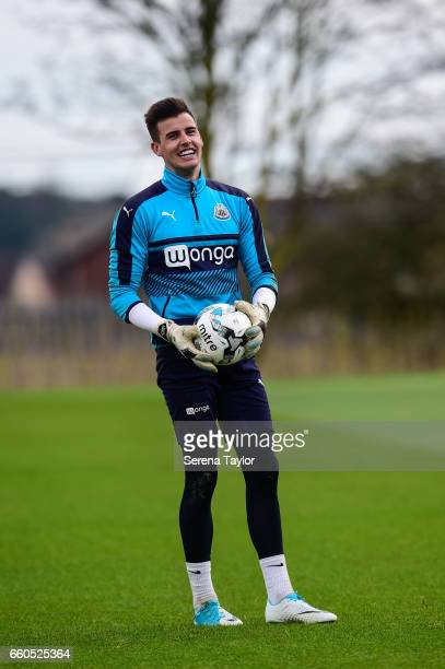 Goalkeeper Karl Darlow holds a ball in his hands laughing during the Newcastle United Training Session at The Newcastle United Training Centre on...