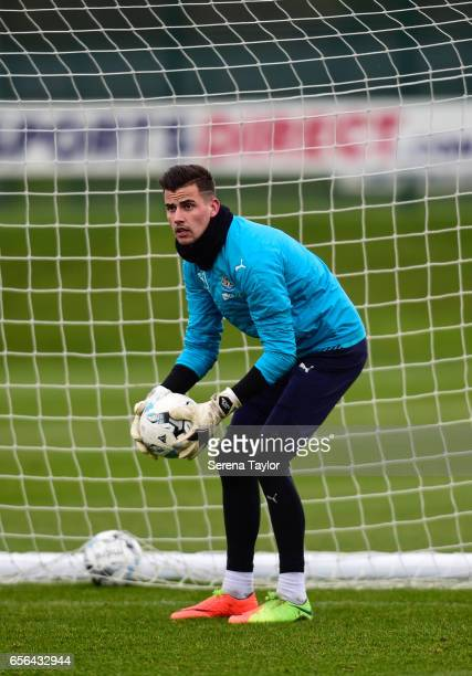Goalkeeper Karl Darlow holds the ball in both hands during the Newcastle United Training Session at The Newcastle United Training Centre on March 22...
