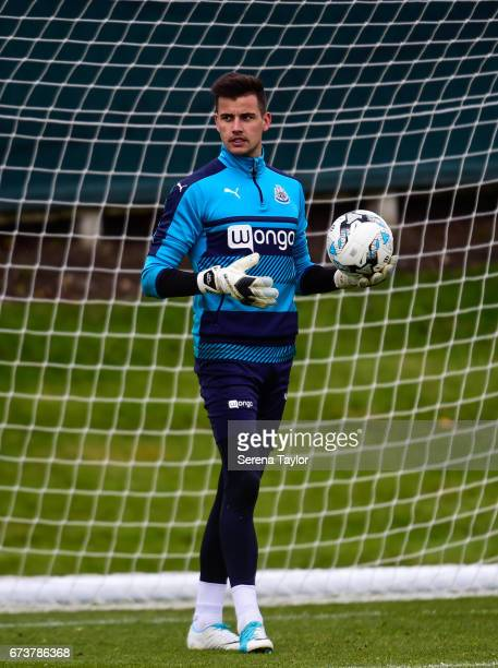 Goalkeeper Karl Darlow holds the ball up in one hand during the Newcastle United Training Session at the Newcastle United Training Ground on April 27...