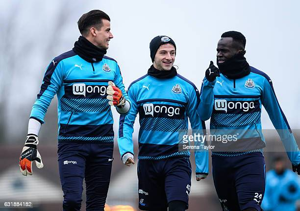 Goalkeeper Karl Darlow Jamie Sterry and Cheick Tiote walk outside during the Newcastle United Training Session at The Newcastle United Training...