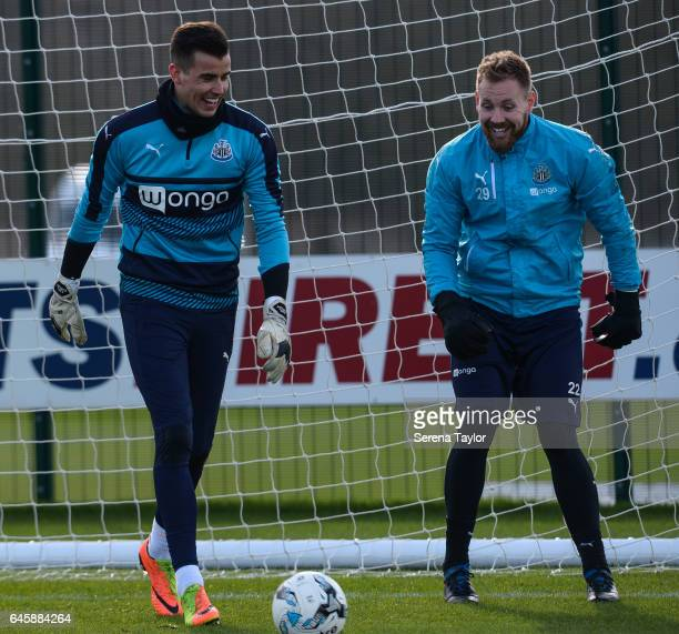 Goalkeeper Karl Darlow laughs in the goal with teammate Rob Elliot during the Newcastle United Training Session at The Newcastle United Training...