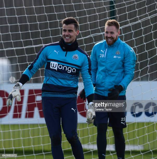 Goalkeeper Karl Darlow laughs with teammate Rob Elliot during the Newcastle United Training Session at The Newcastle United Training Centre on...