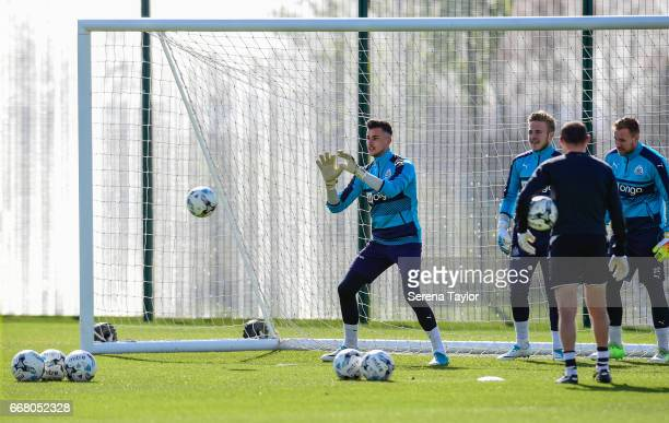 Goalkeeper Karl Darlow looks to catch the ball during the Newcastle United Training Session at The Newcastle United Training Centre on April 13 2017...