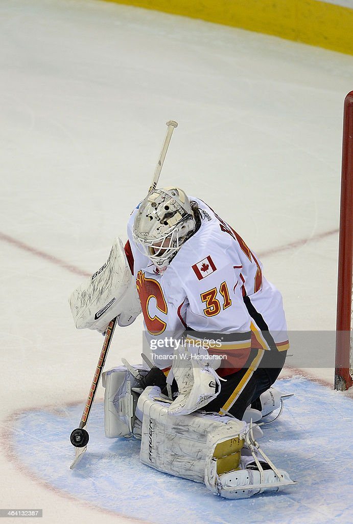 Goalkeeper <a gi-track='captionPersonalityLinkClicked' href=/galleries/search?phrase=Karri+Ramo&family=editorial&specificpeople=716721 ng-click='$event.stopPropagation()'>Karri Ramo</a> #31 of the Calgary Flames blocks a shot with his stick against the San Jose Sharks during the third period at SAP Center on January 20, 2014 in San Jose, California. The Sharks won the game 3-2.