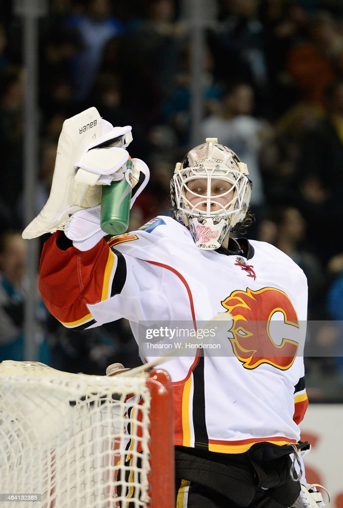 Goalkeeper <a gi-track='captionPersonalityLinkClicked' href=/galleries/search?phrase=Karri+Ramo&family=editorial&specificpeople=716721 ng-click='$event.stopPropagation()'>Karri Ramo</a> #31 of the Calgary Flames grabs the water bottle after giving up a goal to Joe Pavelski (not pictured) of the San Jose Sharks during the second period at SAP Center on January 20, 2014 in San Jose, California. The Sharks won the game 3-2.