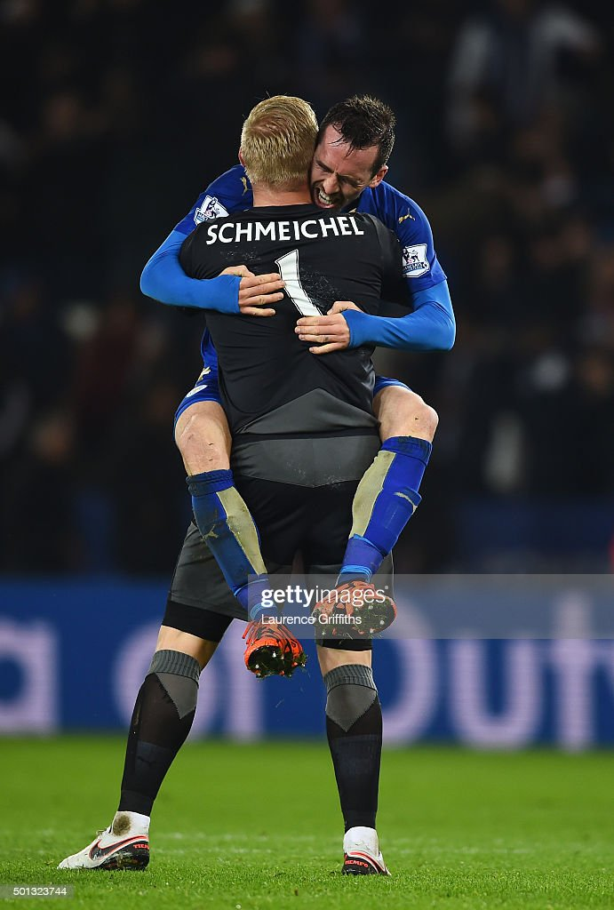 Goalkeeper Kasper Schmeichel of Leicester City and Christian Fuchs of Leicester City celebrate following their team's 2-1 victory during the Barclays Premier League match between Leicester City and Chelsea at the King Power Stadium on December14, 2015 in Leicester, United Kingdom.