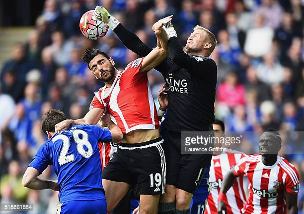 Goalkeeper Kasper Schmeichel of Leicester City attempts to punch clear from Graziano Pelle of Southampton during the Barclays Premier League match...