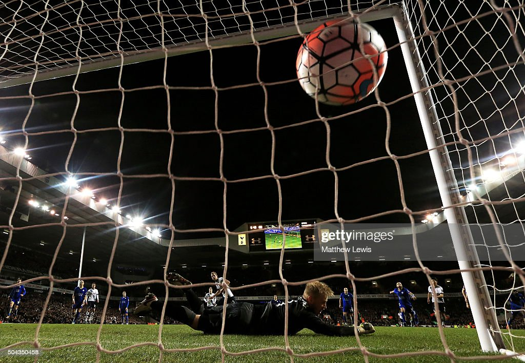 Goalkeeper Kasper Schmeichel of Leicester City dives in vain as Harry Kane of Spurs scores a late penalty to level the scores at 2-2 during The Emirates FA Cup third round match between Tottenham Hotspur and Leicester City at White Hart Lane on January 10, 2016 in London, England.