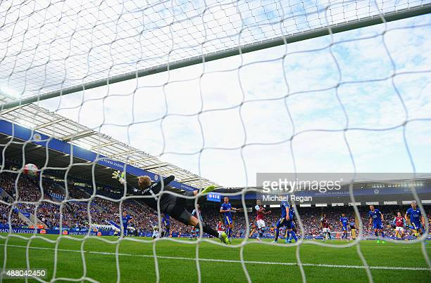 Goalkeeper Kasper Schmeichel of Leicester City fails to stop Jack Grealish of Aston Villa from scoring their first goal during the Barclays Premier...