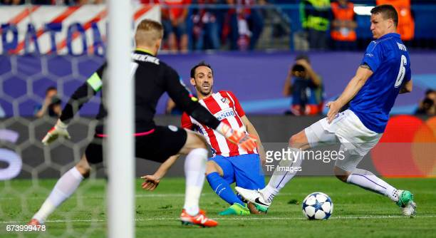 Goalkeeper Kasper Schmeichel of Leicester City Juanfran of Atletico Madrid and Robert Huth of Leicester City battle for the ball during the UEFA...
