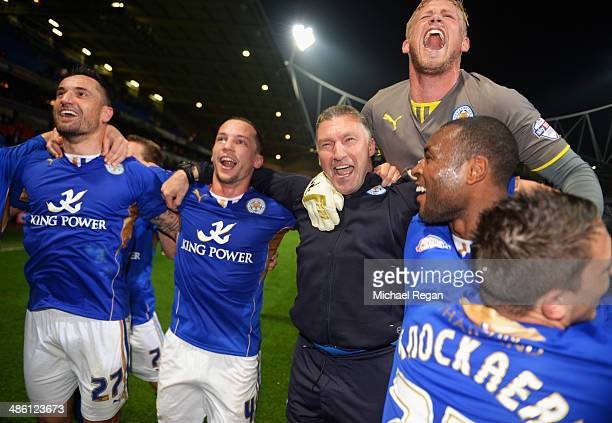 Goalkeeper Kasper Schmeichel of Leicester City jumps on the shoulders of Nigel Pearson manager of Leicester City as he celebrates winning the...