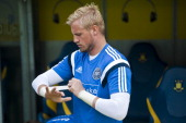Goalkeeper Kasper Schmeichel puts on his gloves prior to a Denmark training session ahead of the International friendly match between Hungary and...