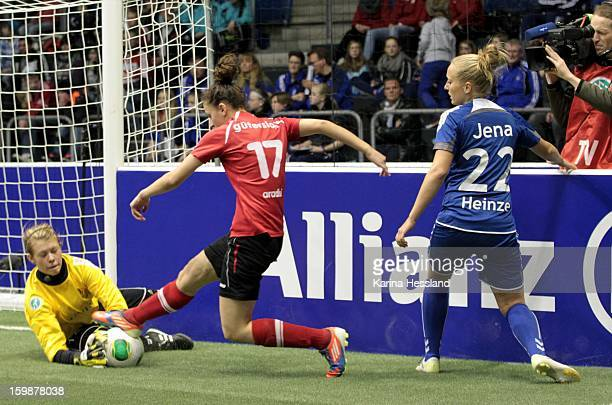 Goalkeeper Katja Schroffenegger of FF USV Jena is challenged by Shpresa Aradini of FSV Guetersloh 2009 during the DFB Women's Indoor Cup 2013 at the...
