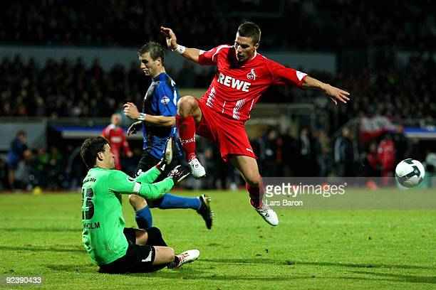 Goalkeeper Kenneth Kronholm of Trier saves a shoot of Lukas Podolski of Koeln during the DFB Cup round of 16 match between Eintracht Trier and 1 FC...