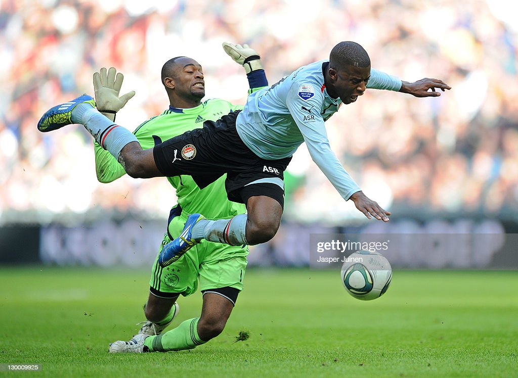 Goalkeeper Kenneth Vermeer of Ajax Amsterdam fouls Guyon Fernandez of Feyenoord for which he received a red card during the Eredivisie match between...