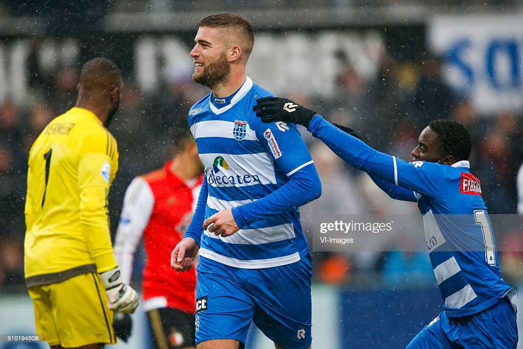 goalkeeper Kenneth Vermeer of Feyenoord, Lars Veldwijk of PEC Zwolle, Queensy Menig of PEC Zwolle during the Dutch Eredivisie match between PEC Zwolle and Feyenoord Rotterdam at the IJsseldelta stadium on February 14, 2016 in Zwolle, The Netherlands