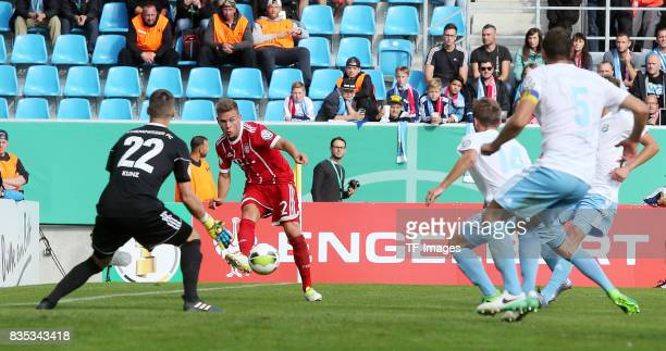 Goalkeeper Kevin Kunz of Chemnitz and Joshua Kimmich of Bayern Muenchen and Jan Koch of Chemnitz and Marc Endres of Chemnitz battle for the ball...