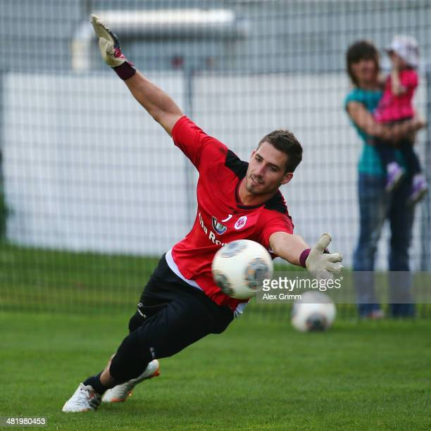 Goalkeeper Kevin Trapp makes a save during an Eintracht Frankfurt training session at Commerzbank Arena on April 2 2014 in Frankfurt am Main Germany