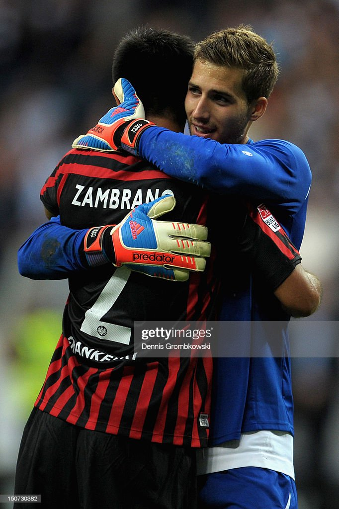 Goalkeeper <a gi-track='captionPersonalityLinkClicked' href=/galleries/search?phrase=Kevin+Trapp&family=editorial&specificpeople=4409868 ng-click='$event.stopPropagation()'>Kevin Trapp</a> of Frankfurt and teammate <a gi-track='captionPersonalityLinkClicked' href=/galleries/search?phrase=Carlos+Zambrano&family=editorial&specificpeople=203225 ng-click='$event.stopPropagation()'>Carlos Zambrano</a> hug after the Bundesliga match between Eintracht Frankfurt and Bayer 04 Leverkusen at Commerzbank-Arena on August 25, 2012 in Frankfurt am Main, Germany.